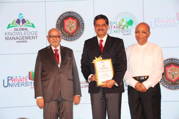 "THUMBAY MOIDEEN CONFERRED WITH AN ""AWARD FOR OUTSTANDING CONTRIBUTION TO EDUCATION"" AT THE WORLD CHANCELLORS CONGRESS 2014 HELD IN MUMBAI."